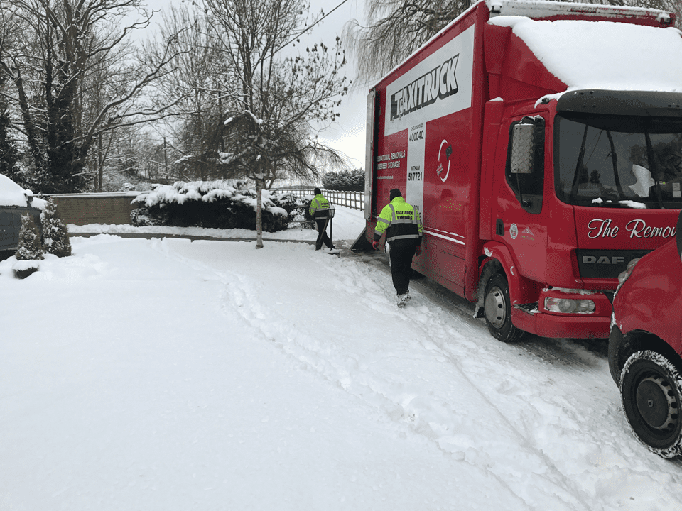 Removal Firm keeps working in snow